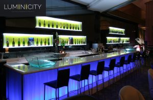 BAR LIGHTING AND BOTTLE WALL IN MODERN STYLING