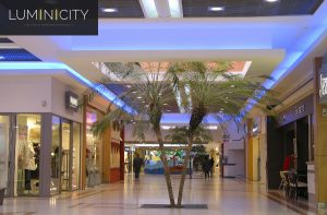 SHOPPING CENTER WITH COLOURFUL OVERHEAD LIGHTING